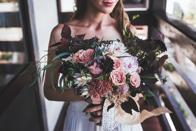 bride with flower arrangement